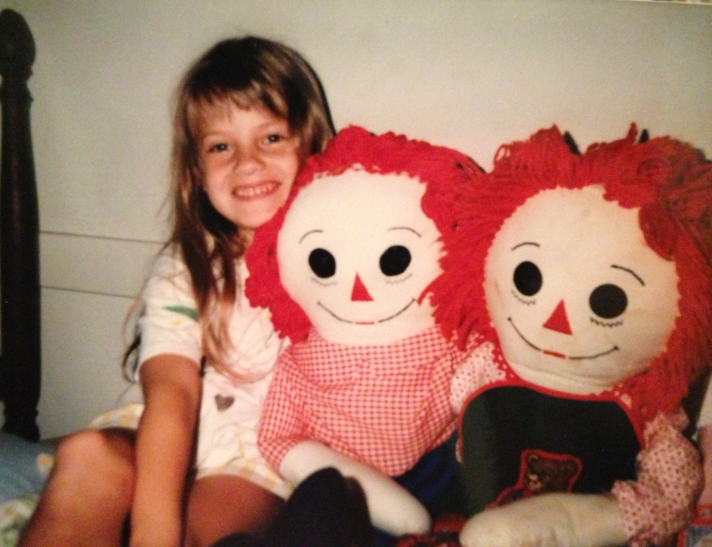 Friday Family nights | blog post by www.yourstrulyelizab.com | photo of young Eliza B. with handmade dolls
